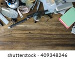 desk of an artist with lots of... | Shutterstock . vector #409348246