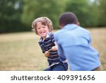 two boys at a tug of war at the ... | Shutterstock . vector #409391656
