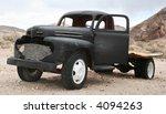 Old Pickup Truck In Desert