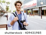 male tourist in city | Shutterstock . vector #409431985