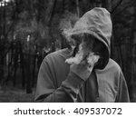man smoking a cigar  produces a ... | Shutterstock . vector #409537072