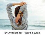girl in sportswear stretches... | Shutterstock . vector #409551286