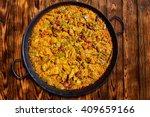 paella from spain rice recipe... | Shutterstock . vector #409659166