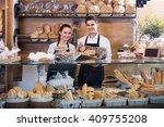 adult man and girl selling... | Shutterstock . vector #409755208
