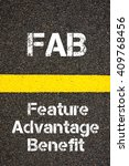 Small photo of Concept image of Business Acronym FAB Feature Advantage Benefit written over road marking yellow paint line