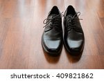 mans black leather shoes on... | Shutterstock . vector #409821862