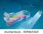 floating bed in the pool to... | Shutterstock . vector #409865365