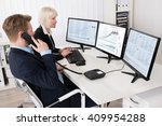 two businesspeople analyzing... | Shutterstock . vector #409954288