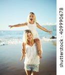 happy mother and young daughter ... | Shutterstock . vector #409990678