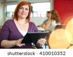 confident female designer... | Shutterstock . vector #410010352