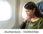 Small photo of Fear of flying woman in plane airsick