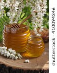 Small photo of Acacia honey jar with a dipper / Acacia tree blossoms