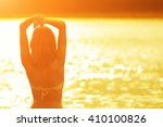 girl enjoying on a beach near... | Shutterstock . vector #410100826