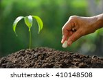 farmer's hand planting seeds in ... | Shutterstock . vector #410148508