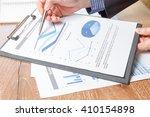 business man analyzing graph... | Shutterstock . vector #410154898