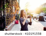 woman making photos of the city.... | Shutterstock . vector #410191558
