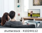 young asian couple watching... | Shutterstock . vector #410244112