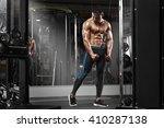 muscular man working out in gym ... | Shutterstock . vector #410287138