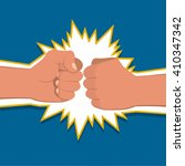 two clenched fists in air... | Shutterstock .eps vector #410347342