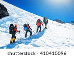 goup of climbers reaching the... | Shutterstock . vector #410410096