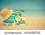 flip flops and bag on sandy... | Shutterstock . vector #410458702
