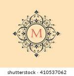 letter m floral monogram. | Shutterstock .eps vector #410537062
