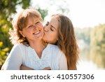teenage girl hugging and... | Shutterstock . vector #410557306