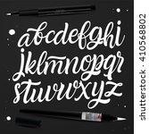 handwritten calligraphy font.... | Shutterstock .eps vector #410568802