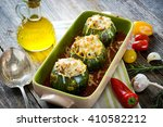 round zucchini stuffed with... | Shutterstock . vector #410582212