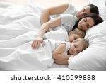 family sleeping in bed  closeup | Shutterstock . vector #410599888