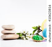 Small photo of Spa salt, stones, towel, wisp, flower branch and bath bomb for beauty and health. Healthy relaxation, therapy and treatment. Aromatherapy, body care, aroma massage. Alternative lifestyle