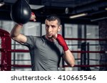 young male boxer using a... | Shutterstock . vector #410665546