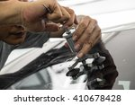 mechanic using repairing... | Shutterstock . vector #410678428