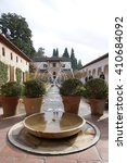 Small photo of Granada, Spain - 9 December,2015 : Patio de la Acequia (Court of the Water Channel) with water fountain and beautiful garden, Granada, Spain on 9 December 2015 in