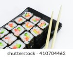 sushi on a black plate with... | Shutterstock . vector #410704462