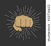 fist with sunbursts in vintage... | Shutterstock .eps vector #410716612