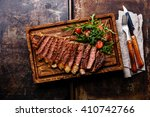 sliced grilled beef barbecue... | Shutterstock . vector #410742766