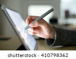 woman using pen on tablet pc | Shutterstock . vector #410798362