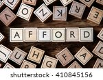 Small photo of the word of AFFORD on building blocks concept