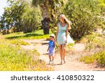 mother and son walking on nature | Shutterstock . vector #410850322