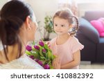 mothers day  little girl giving ... | Shutterstock . vector #410882392
