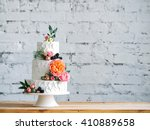 White Wedding Cake With Flower...