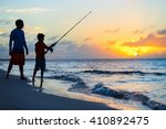 father and son fishing together ... | Shutterstock . vector #410892475
