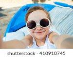 adorable little girl making... | Shutterstock . vector #410910745