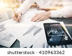 Small photo of Investment manager working process.Picture trader work market report modern tablet.Using electronic device.Graphic icons,stock exchange reports screen.Business project startup.Horizontal,film effect