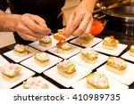 cook put red caviar on prepared ...   Shutterstock . vector #410989735