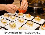cook put red caviar on prepared ... | Shutterstock . vector #410989762
