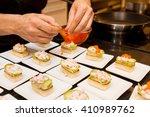cook put red caviar on prepared ...   Shutterstock . vector #410989762