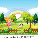 girl throwing bone for dog in... | Shutterstock .eps vector #411027478