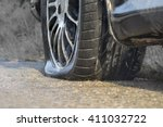 car flat tire in rainy day | Shutterstock . vector #411032722